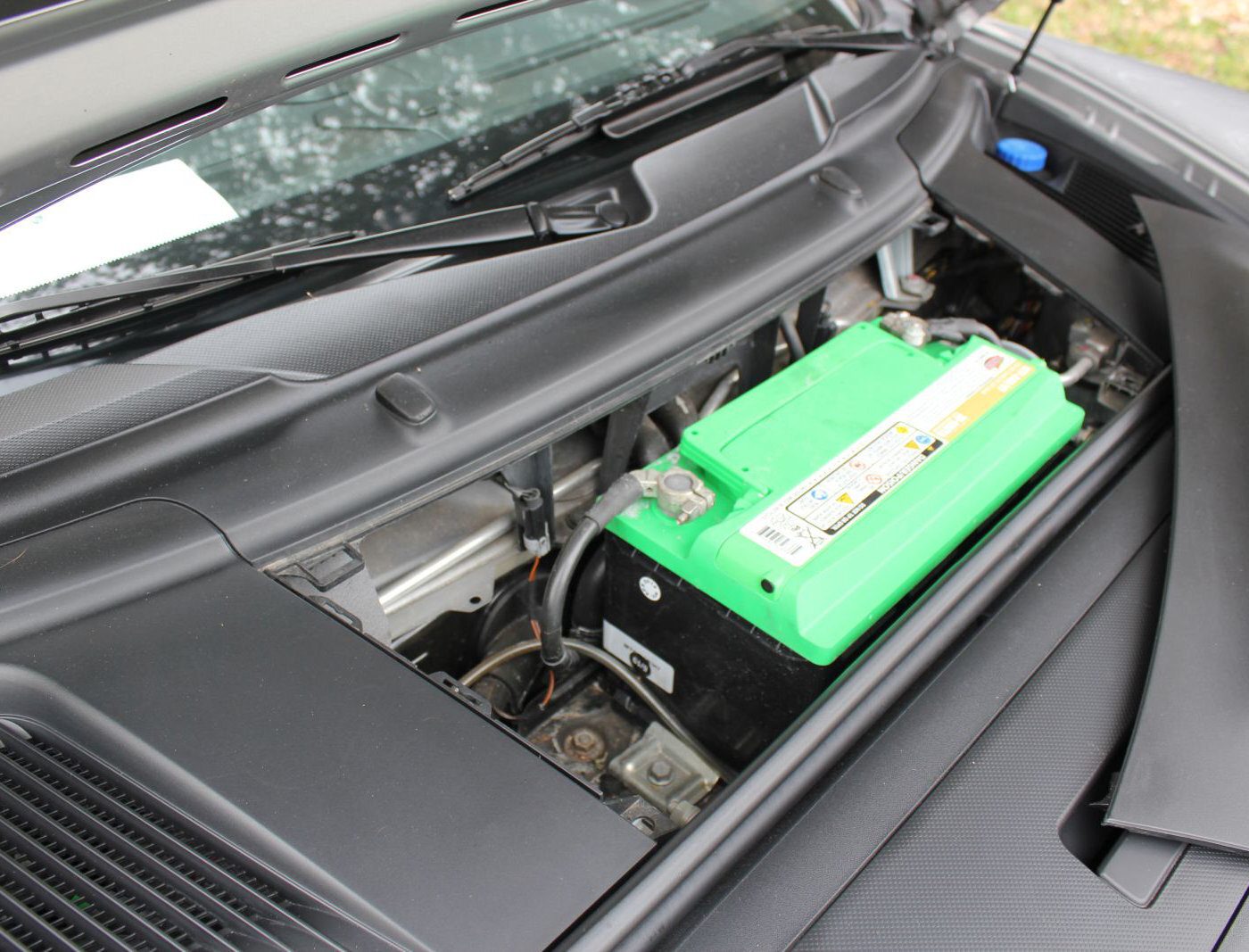 (Sample) The engine compartment from a 2009 Porsche Cayman